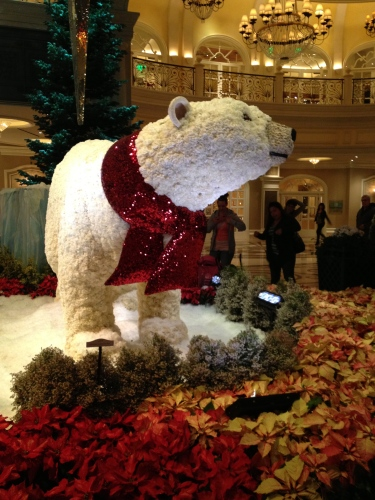 The center of attention -- a polar bear of white carnations.