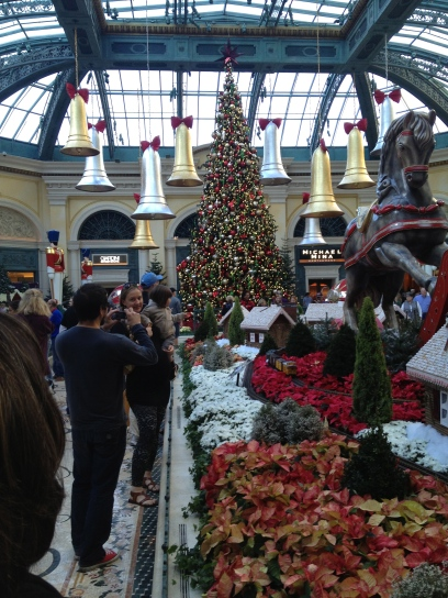 Visitors snapping pics of the Christmas bells and ceiling-height tree
