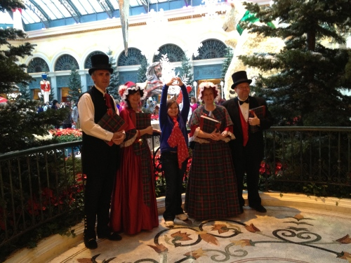 What fun!  A picture with the Carolers at Bellagio!