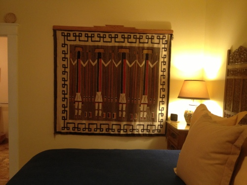 A focal point of the room -- this folksy rug hung as art.