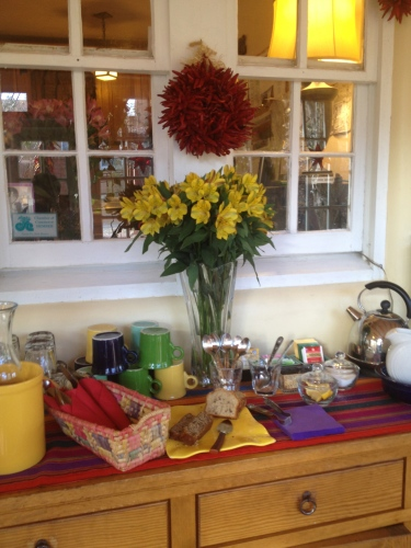 Beautiful buffet setting with rostra (wreath of red chile peppers) above.