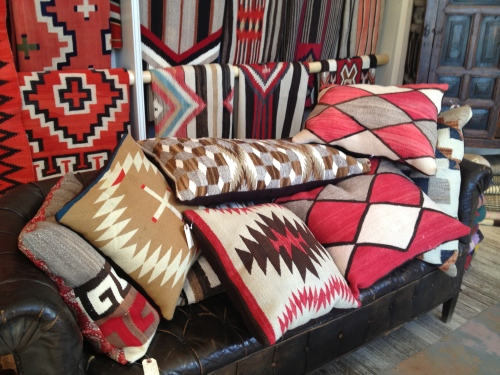 Rugs, saddle blankets, and pillows for sale at Shiprock.