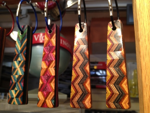 Colored pieces of inlaid wood adorn these key rings at Cutlery of Santa Fe.