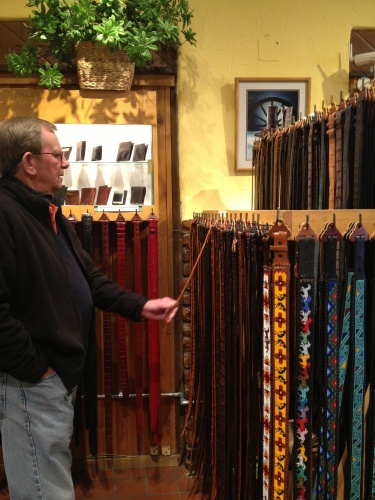 Bert admires the finely wrought belts that can be added to artisan buckles at Tom Taylor.