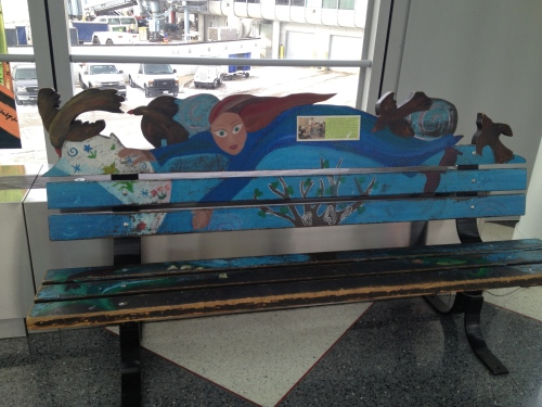 One of the creatively painted benches lining the corridor leading to Terminal 1.