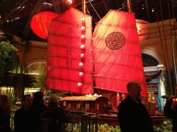 Brilliant red sails anchor the color scheme for the gardens