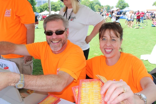 Happy ticket sellers wearing Big Orange!