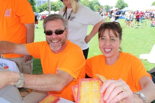 Happy ticket sellers wearing Big Orange!