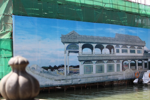 While undergoing renovation, this painting of the Marble Boat covers the actual structure.