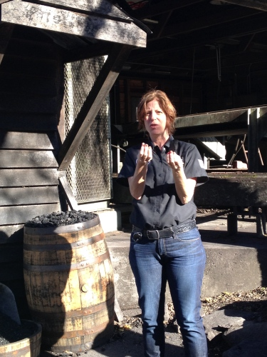 Guide telling us how Jack Daniel's Whiskey is mellowed through hard sugar maple charcoal