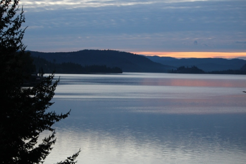 Spectacular sundown view of the lake from the porch at Lodge at Sandpoint