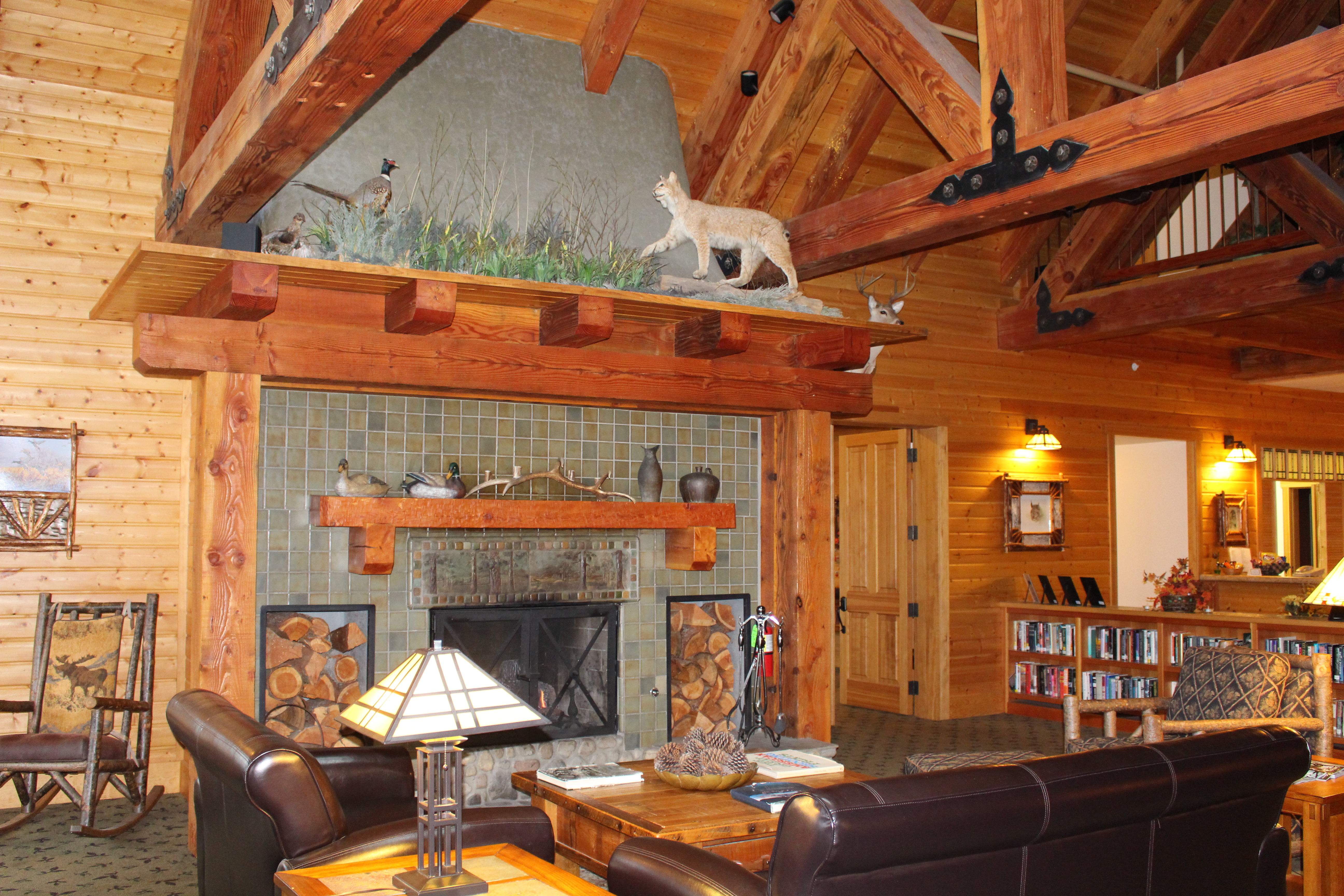 fireplace in the main lobby where beamed ceilings and lodge furniture invite relaxation - Lodge Furniture