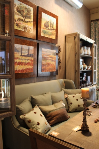 Soft colors of upholstered pieces contrast with color artwork on the walls