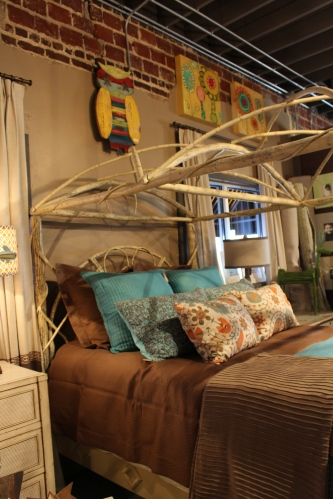 A twig bed decorated with natural colors and touches of blue