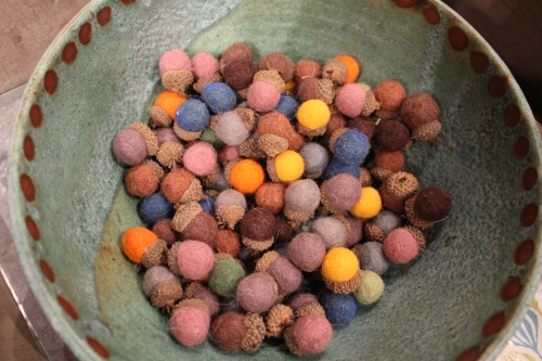 Felted acorns rest easy in a big blue bowl.