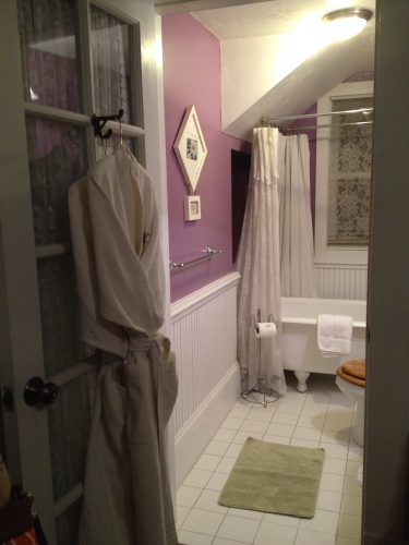 Bathroom adjoining Lilac Room with spa-like robes on the door