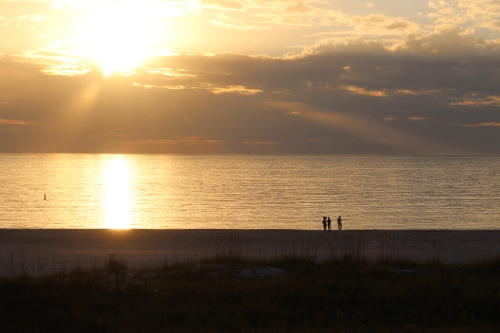 Walking the beach at sunset