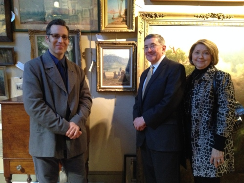 Paul James, Executive Director of Ijams Nature Center admires the Wiley painting with Earl Henry, Jr., and his wife Marilyn