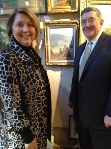 Marilyn Henry and Earl Henry, Jr., stand beside the Catherine Wiley painting they sold at auction to benefit Ijams Nature Center