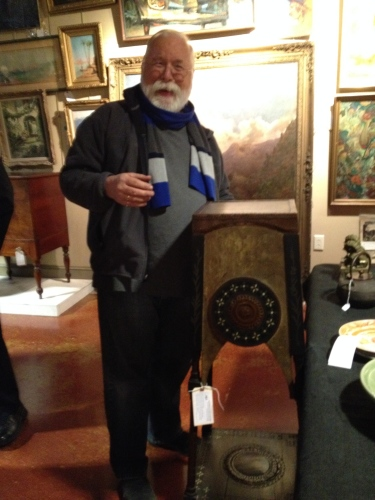 Scott Bishop, Owner of Westwood Antiques, admiring a Carlo Bugatti stand