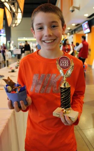 Donovan Scott, proud winner of 2nd Place, Junior Division for his Llama Llama Red Pajama cupcake!