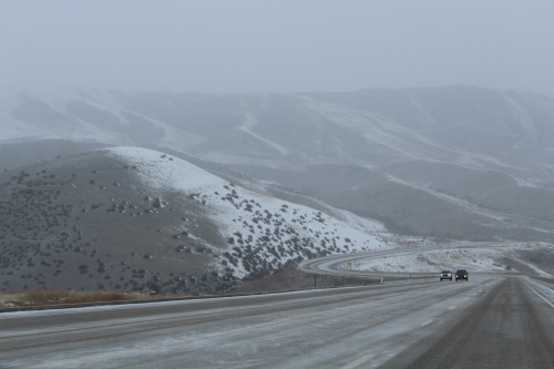 Idaho 55 almost abandoned except for snow plows and a few travelers