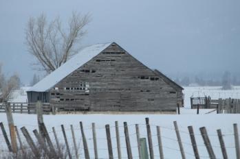 Old barn on snowy day