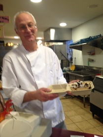 Paul Wegner prepares take-out dessert