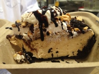 Peanut butter pie drizzled with chocolate and whipped cream