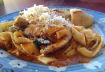 Chicken Fiori served over pasta with tomato ragu