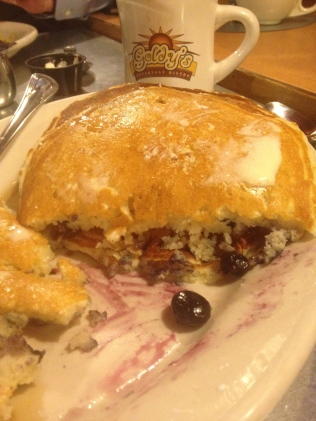 Pancakes packed with blueberries at Goldy's