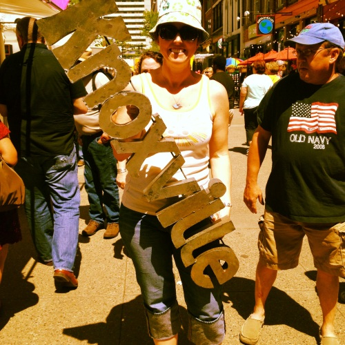Woman carrying Knoxville sign.