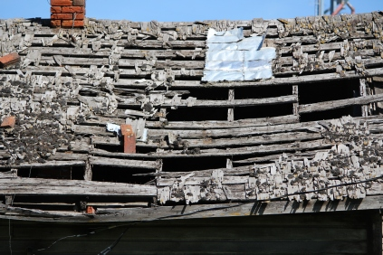 Time-ravaged roof of an abandoned barn