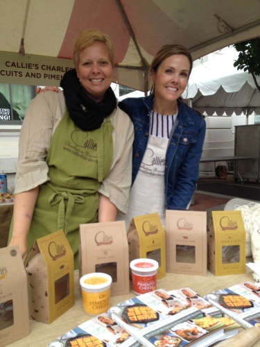 Callie's ladies show off cookbooks, products, and great biscuits!
