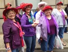Red Hat Ladies on the street corner listening to music