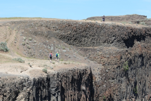 Hikers walking toward Palouse Falls