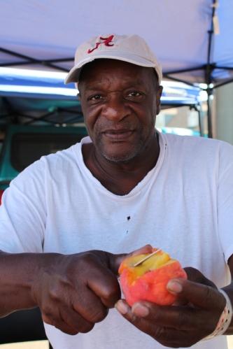 Alabama fan serving peaches