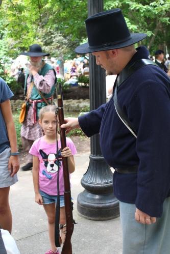 Jeremy Hall, Union soldier, shows Zoe his Civil War firearm.