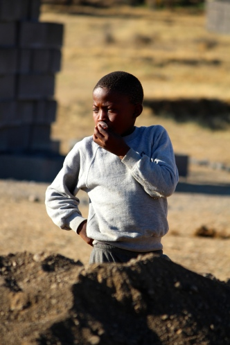 Boy waiting for house in Lesotho