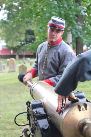 Firing the cannon at Old Gray Cemetery