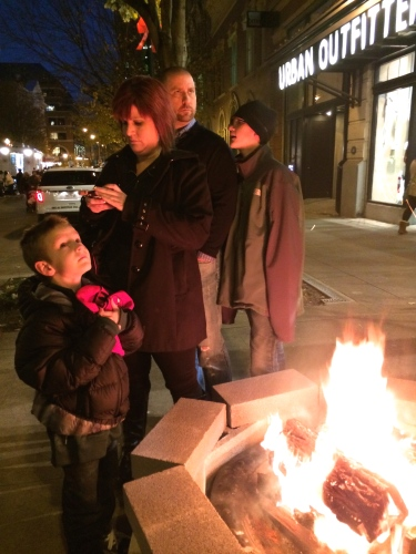 Huddled around the fire in front of Urban Outfitters, Knoxville