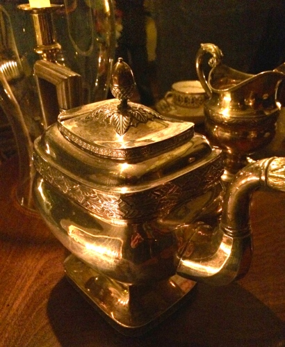Silver service glows from the candlelight in the dining room, Ramsey House
