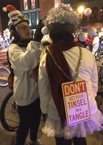Untangling a rider's attire, Tour de Lights, Knoxville