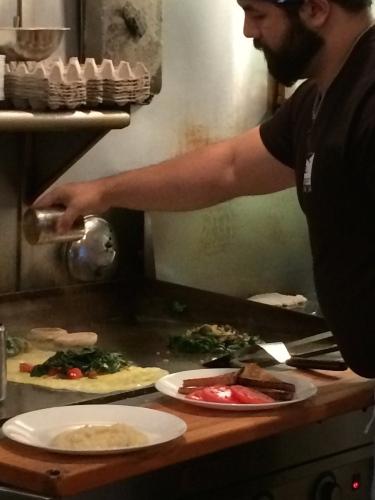 Chef preparing Florentine Omelette