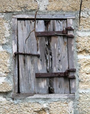 Detail of window on small stone house behind Gonzalez-Alvarez House