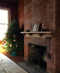 Fireplace and mantel decorated at Christmas