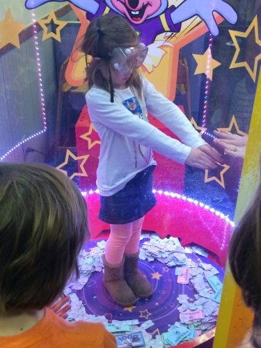 Standing in the Ticket Blaster at Chuck E. Cheese.