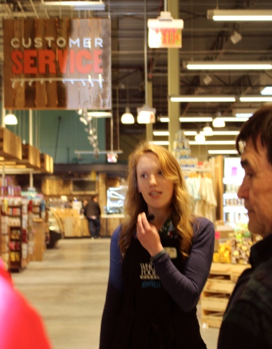 Caitie from the Asheville, NC store leads a pre-opening tour at Whole Foods Knoxville