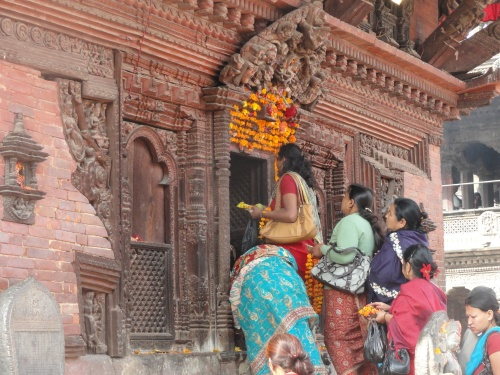 Women bringing tributes to a temple in Katmandu
