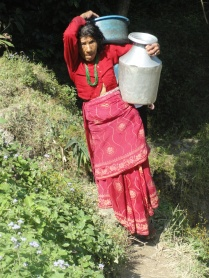 Grandmother in the family complex carrying water up the steep mountain from the quarry below.